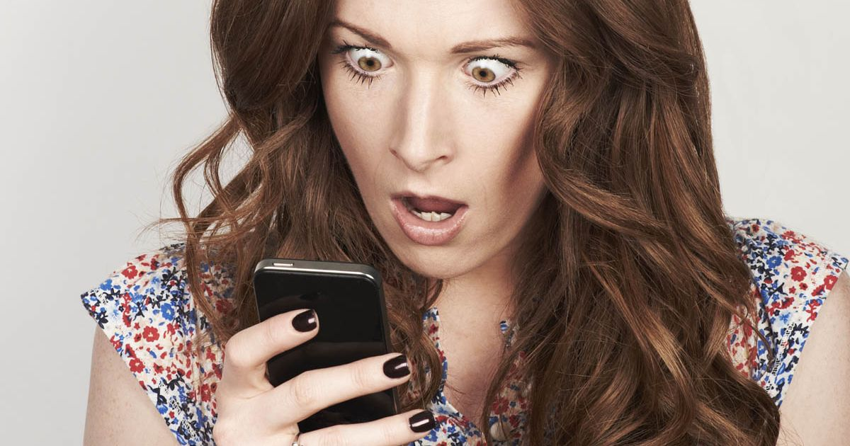 A-shocked-woman-looking-at-her-phone